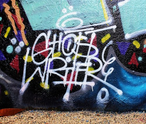Spray-painted word Ghostwriter on wall