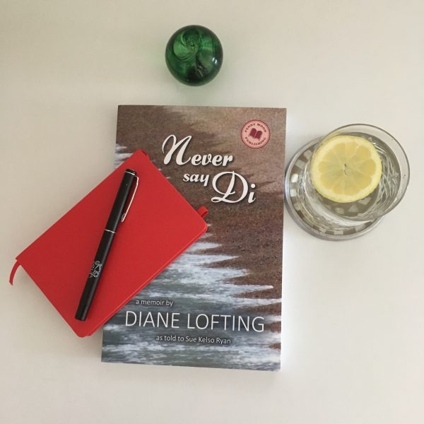 Book Never Say Di with G&T and notepad